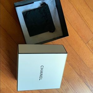 Chanel box empty and a small dust bag.